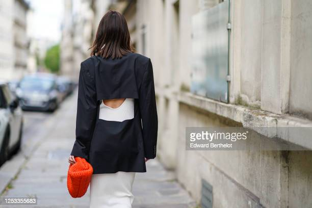 Geraldine Boublil wears Moscot sunglasses a white dress from Basilika a Gauge 81 navy dark blue oversized blazer jacket with a large cutout in the...