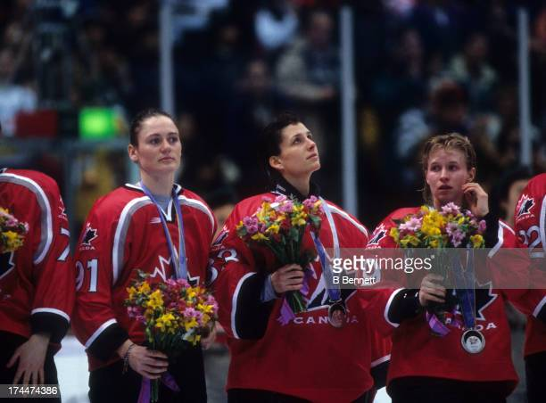 Geraldine Heaney and Manon Rheaume of Team Canada receive their silver medal after being defeated by Team United States after the Gold Medal Game in...