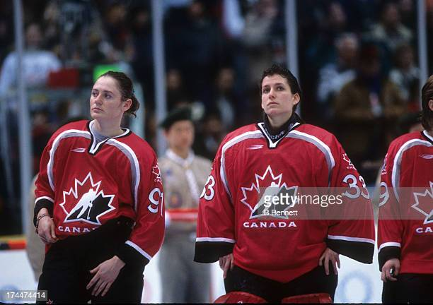 Geraldine Heaney and Manon Rheaume of Team Canada wait to receive their silver medal after being defeated by Team United States after the Gold Medal...