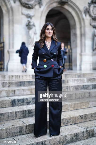 Geraldine Nakache wears a necklace a blazer jacket featuring colored buttons flare pants outside the Opera Garnier 350th Anniversary Gala in Paris on...