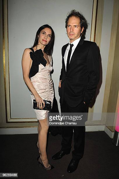 Geraldine Pailhas and Christopher Thompson attend Fashion Dinner for AIDS at Pavillon d'Armenonville on January 28 2010 in Paris France
