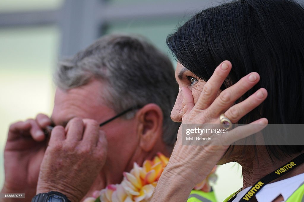 Geraldine Parkinson wipes away a tear as Joel Parkinson arrives home at the Gold Coast airport on December 19, 2012 on the Gold Coast, Australia. Parkinson won the Pipeline Masters and his first ASP World Title on Monday.