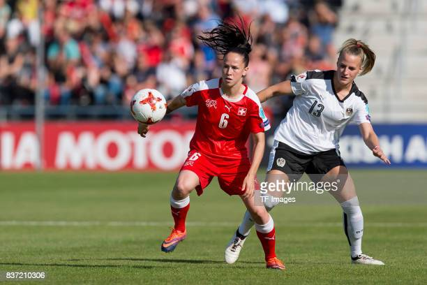Geraldine Reuteler of Switzerland and Virginia Kirchberger of Austria battle for the ball during the Group C match between Austria and Switzerland...