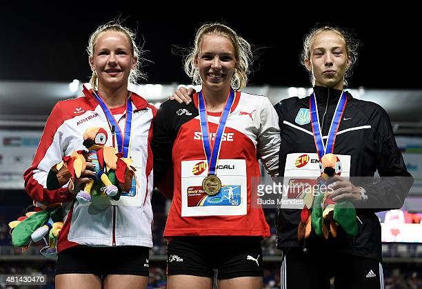 Geraldine Ruckstuhl of Switzerland gold medal Sarah Lagger of Austra silver medal and Alina Shukh of the Ukraine bronze medal celebrate on the podium...