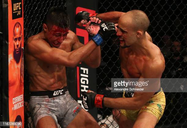 Geraldo de Freitas of Brazil punches Chris Gutierrez in their bantamweight fight during the UFC Fight Night event at Antel Arena on August 10 2019 in...
