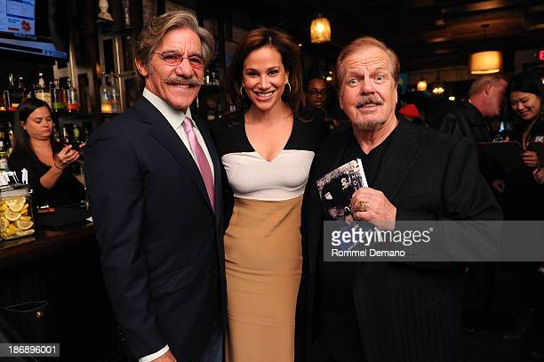 Geraldo Rivera Erica Levy and Author Mike Walker attend the Out For Blood book launch event at Ivy Bar And Grill on November 4 2013 in New York City