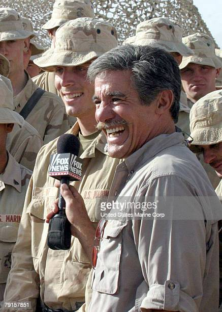 Geraldo Rivera from the Fox News Channel smiles for the camera as he chats with Sgt Johnny Huff of Richmond Virginia during a live broadcast of At...