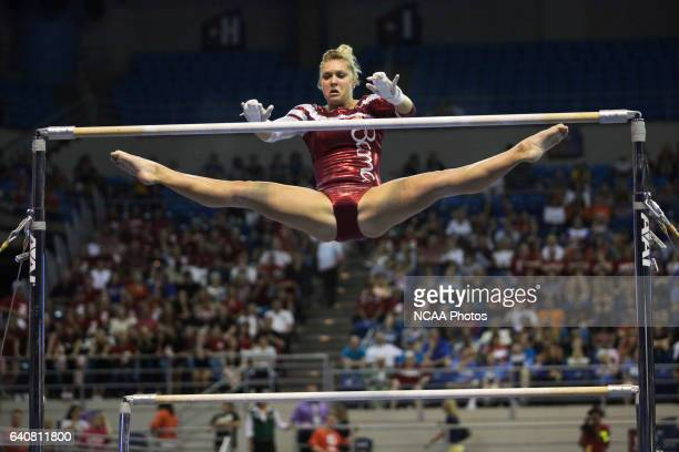 Geralen StackEaton of the University of Alabama competes on the bars during the Division I Women's Gymnastics Championship held at the Stephen C...