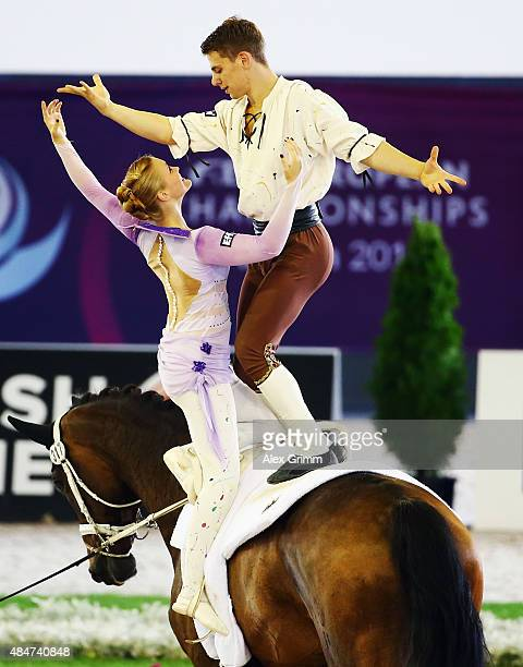GeraMarie Gruen and Justin van Gerven of Germany perform during the Vaulting Pas de Deux freestyle test on Day 10 of the FEI European Equestrian...