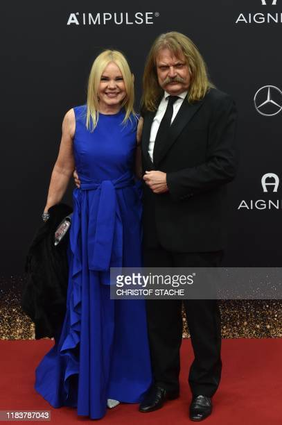 Geramn singer Leslie Mandoki and his wife Eva pose on the red carpet upon their arrival for the Bambi media prize ceremony on November 21, 2019 at...