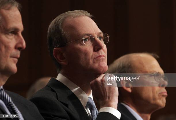 Gerard Arpey chairman of American Airlines listens to testimony November 10 at a US Senate hearing on the Wright Amendment which restricts flights...