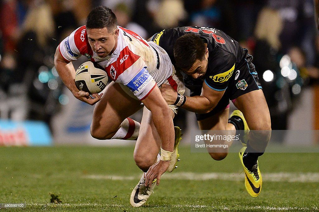 Gerard Beale of the Dragons is tackled during the round 14 NRL match between the Penrith Panthers and the St George Illawarra Dragons at Sportingbet Stadium on June 14, 2014 in Sydney, Australia.