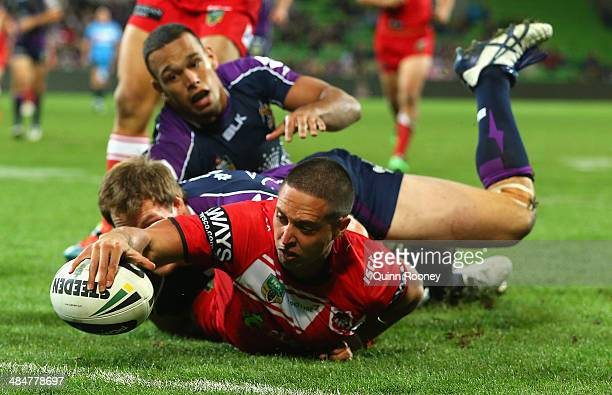 Gerard Beale of the Dragons scores a try infront of Tim Glasby and Will Chambers of the Storm during the round 6 NRL match between the Melbourne...