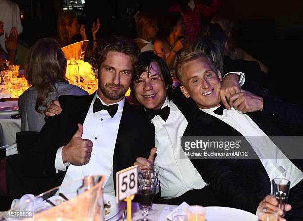 Gerard Butler Alan Siegel and David Meister attend the 2012 amfAR's Cinema Against AIDS during the 65th Annual Cannes Film Festival at Hotel Du Cap...
