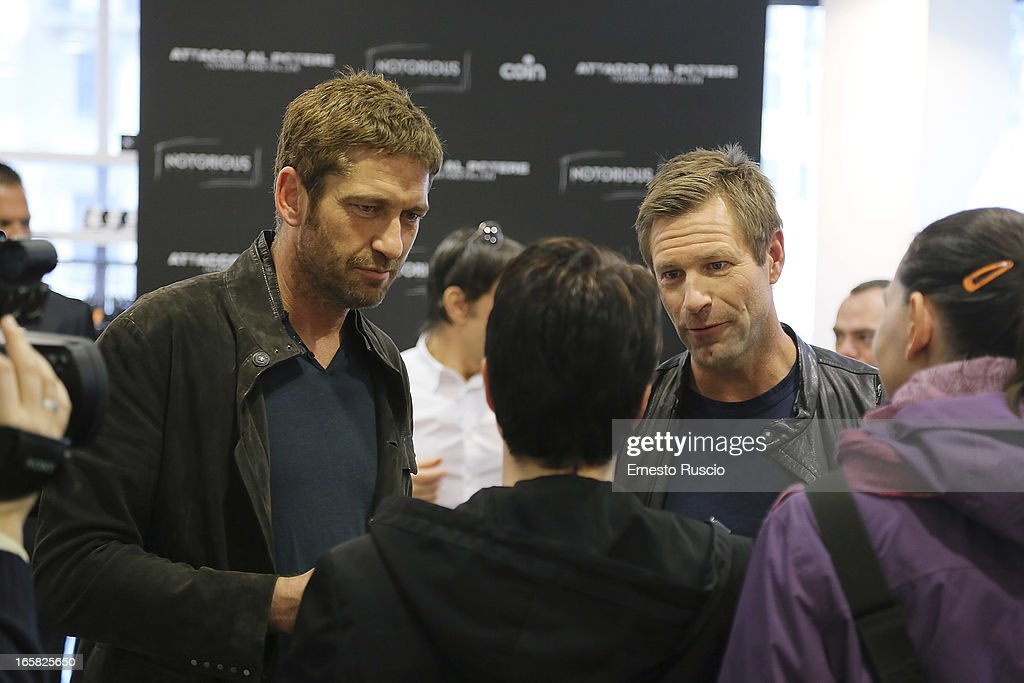 Gerard Butler and Aaron Eckhart Meet fans at Coin on April 6, 2013 in Rome, Italy.