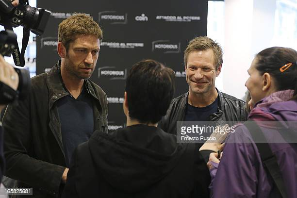 Gerard Butler and Aaron Eckhart Meet fans at Coin on April 6 2013 in Rome Italy