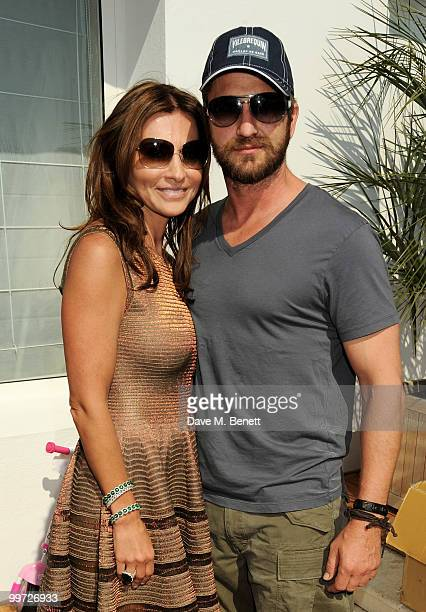Gerard Butler and Ella Krasner attend the Amend Charity Luncheon at the Hotel du Cap as part of the 63rd Cannes Film Festival on May 17 2010 in...