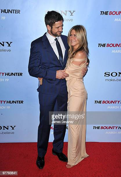 Gerard Butler and Jennifer Aniston attend the premiere of 'The Bounty Hunter' at Ziegfeld Theatre on March 16 2010 in New York New York City