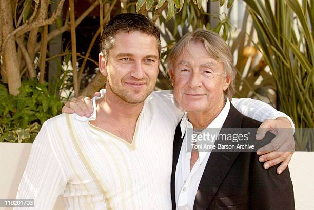 Gerard Butler and Joel Schumacher during 2004 Cannes Film Festival Andrew Lloyd Webber's Phantom Of The Opera Photocall at Palais Du Festival in...