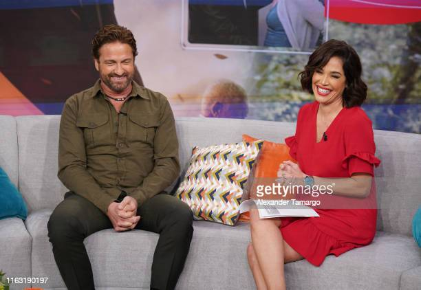 Gerard Butler and Karla Martinez are seen on the set of Despierta America at Univision Studios to promote the film Angel Has Fallen on August 22 2019...