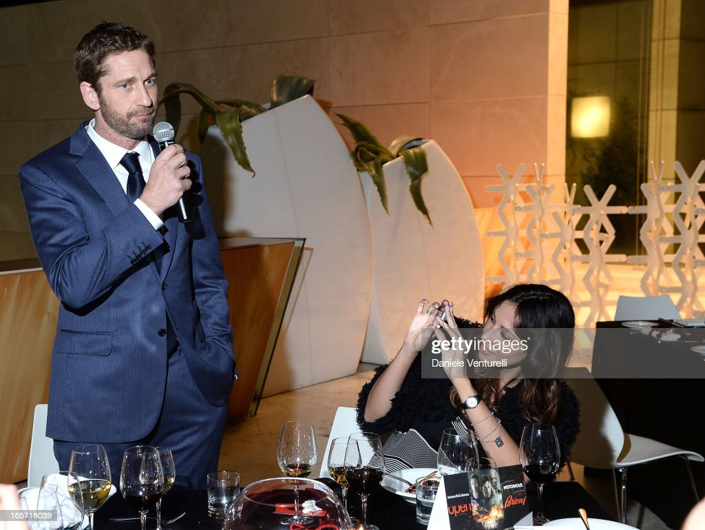 Gerard Butler and Madalina Ghenea attend a gala dinner by Antonello Colonna for the movie 'Olympus Has Fallen' on April 5, 2013 in Rome, Italy.