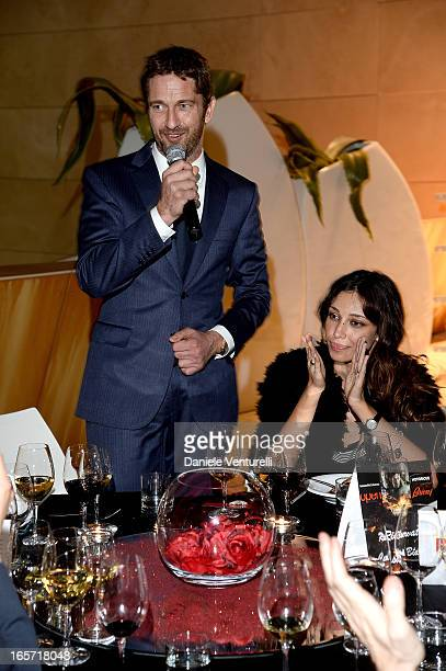 Gerard Butler and Madalina Ghenea attend a gala dinner by Antonello Colonna for the movie 'Olympus Has Fallen' on April 5 2013 in Rome Italy
