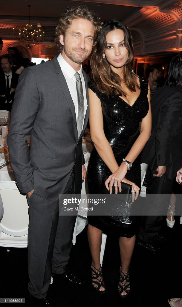 Gerard Butler (L) and Madalina Ghenea attend the IWC and Finch's Quarterly Review Annual Filmmakers Dinner at Hotel Du Cap-Eden Roc on May 21, 2012 in Antibes, France.