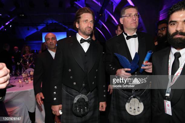 Gerard Butler and Magnus MacFarlane Barrow during the Cinema For Peace Gala at Westhafen Event & Convention Center on February 23, 2019 in Berlin,...