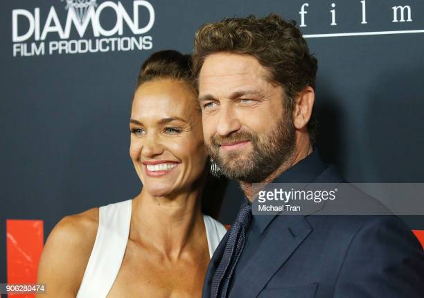 Gerard Butler and Morgan Brown arrive to Los Angeles premiere of STX Films' Den Of Thieves held at Regal LA Live Stadium 14 on January 17 2018 in Los...