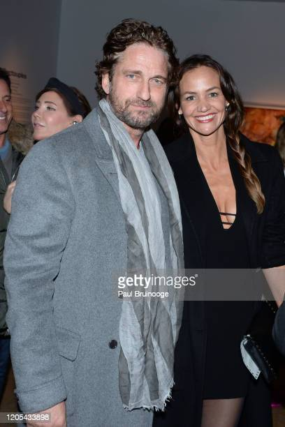 "Gerard Butler and Morgan Brown attend Sony Pictures Classics And The Cinema Society Host The After Party For ""The Burnt Orange Heresy"" at New York..."