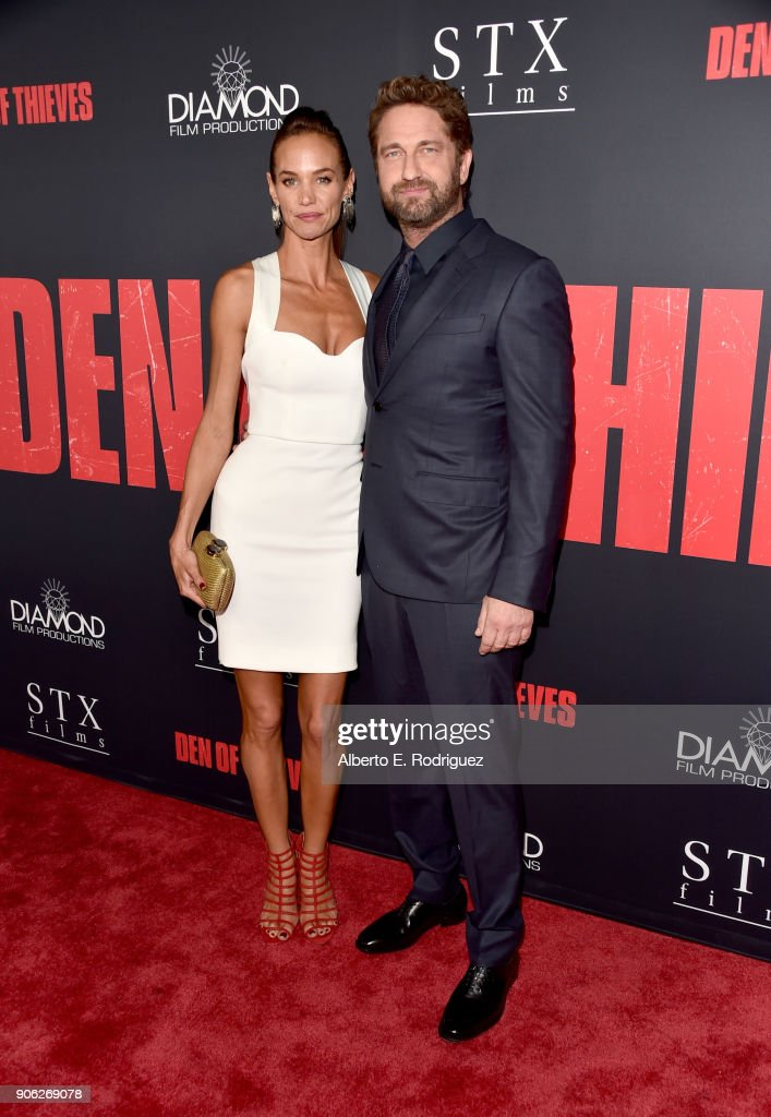 Gerard Butler (R) and Morgan Brown attend the premiere of STX Films' 'Den of Thieves' at Regal LA Live Stadium 14 on January 17, 2018 in Los Angeles, California.