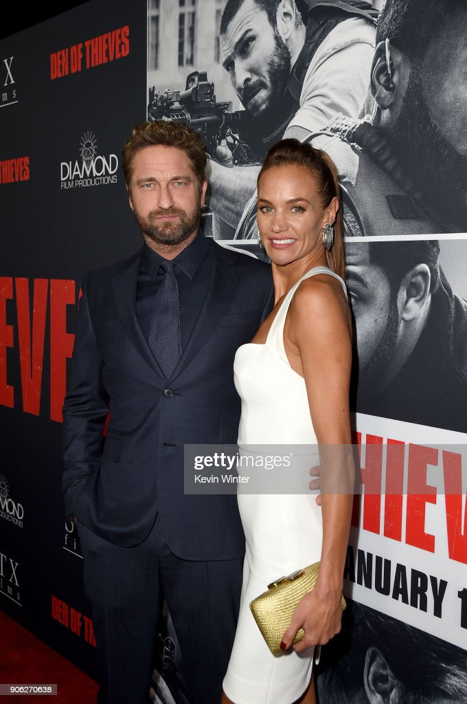 Gerard Butler (L) and Morgan Brown attend the premiere of STX Films' 'Den of Thieves' at Regal LA Live Stadium 14 on January 17, 2018 in Los Angeles, California.