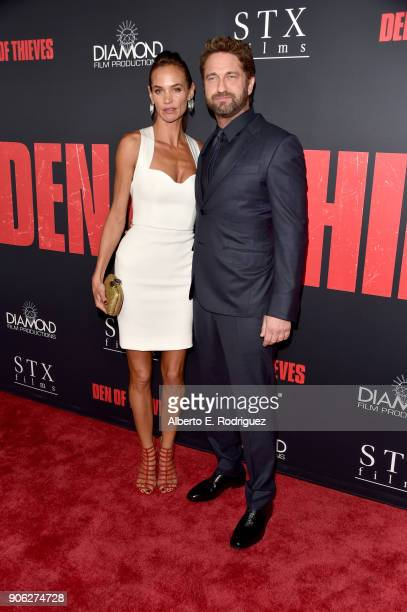 Gerard Butler and Morgan Brown attend the premiere of STX Films' Den of Thieves at Regal LA Live Stadium 14 on January 17 2018 in Los Angeles...