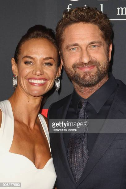 Gerard Butler and Morgan Brown attend the Premiere Of STX Films' 'Den Of Thieves' at Regal LA Live Stadium 14 on January 17 2018 in Los Angeles...