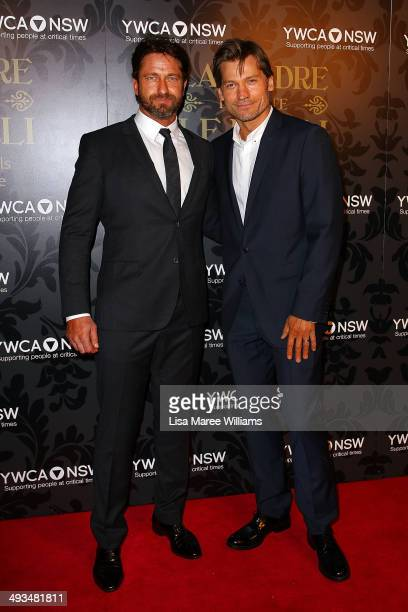 Gerard Butler and Nikolaj CosterWaldau attend the YMCA Mother of All Balls at Town Hall on May 24 2014 in Sydney Australia