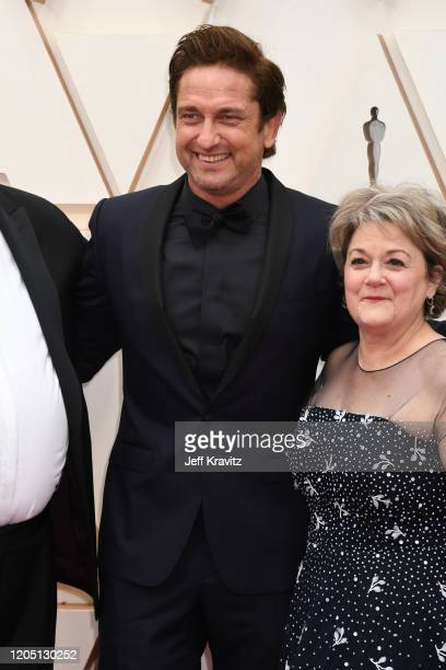 Gerard Butler and producer Bonnie Arnold attend the 92nd Annual Academy Awards at Hollywood and Highland on February 09 2020 in Hollywood California