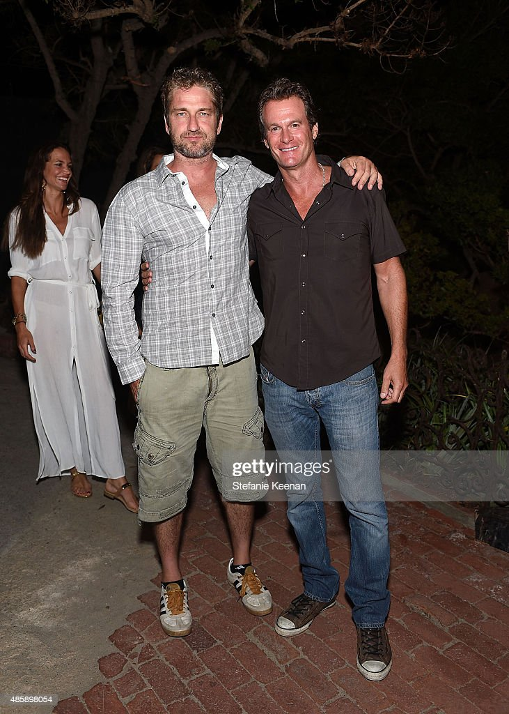 Gerard Butler and Rande Gerber attend Kelly Slater, John Moore and Friends Celebrate the Launch of Outerknown at Private Residence on August 29, 2015 in Malibu, California.
