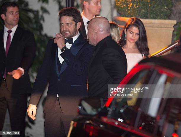 Gerard Butler and Selena Gomez seen at the CAA Golden Globe Awards after party at Sunset Tower Hotel in West Hollywood on January 11 2016 in Los...
