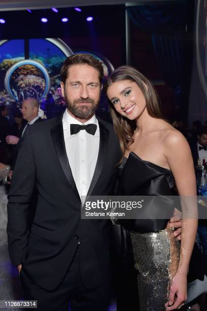 Gerard Butler and Taylor Hill attend the UCLA IoES honors Barbra Streisand and Gisele Bundchen at the 2019 Hollywood for Science Gala on February 21...