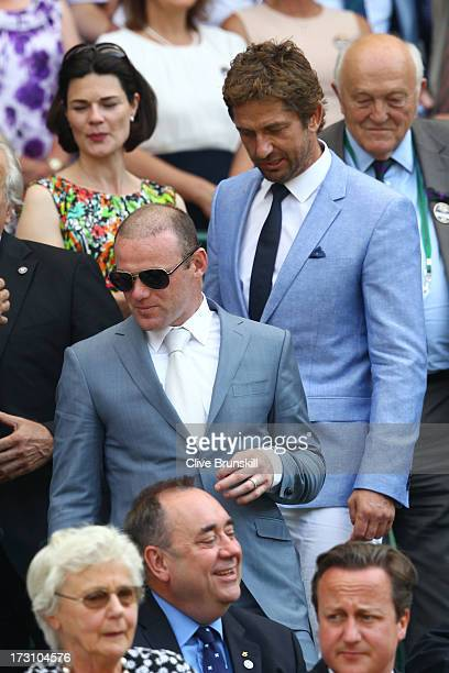 Gerard Butler and Wayne Rooney attend the Gentlemen's Singles Final match between Andy Murray of Great Britain and Novak Djokovic of Serbia on day...