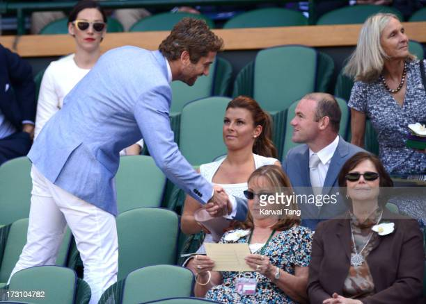 Gerard Butler, Coleen Rooney and Wayne Rooney attend the Men's Singles Final between Novak Djokovic and Andy Murray on Day 13 of the Wimbledon Lawn...