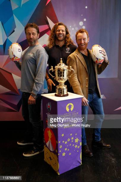Gerard Butler former USA Eagles captain Todd Clever and Tony Curran pose for photos with The Webb Ellis Cup during day two of the Rugby World Cup...
