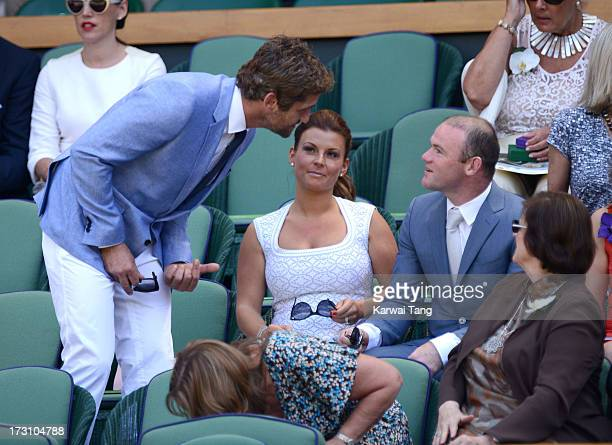 Gerard Butler greets Coleen Rooney and Wayne Rooney before the Men's Singles Final between Novak Djokovic and Andy Murray on Day 13 of the Wimbledon...