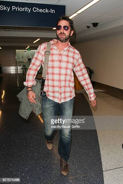 Gerard Butler is seen at LAX on December 01 2016 in Los Angeles California