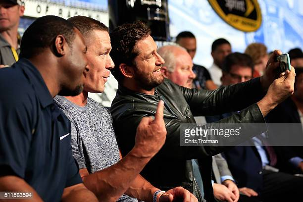 Gerard Butler John Cena and Ken Griffey Jr take a selfie at the driver's meeting prior to the NASCAR Sprint Cup Series DAYTONA 500 at Daytona...