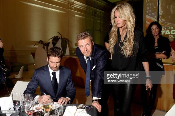 Gerard Butler Kaspar Capparoni and Tiziana Rocca attend the gala dinner by Antonello Colonna for the movie 'Olympus Has Fallen' on April 5 2013 in...