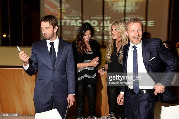 Gerard Butler Madalina Ghenea Kaspar Capparoni and Tiziana Rocca attend the gala dinner by Antonello Colonna for the movie 'Olympus Has Fallen' on...
