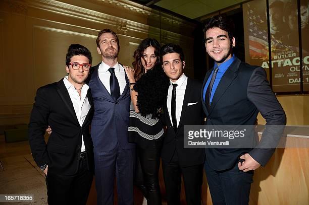 Gerard Butler Madalina Ghenea Piero Barone Gianluca Ginoble and Ignazio Boschetto of Il Volo attend the gala dinner by Antonello Colonna for the...