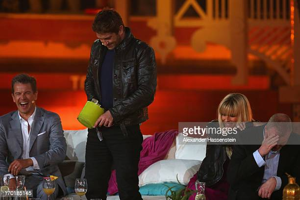 Gerard Butler performes during the 'Wetten dass' TV show presented by German host Markus Lanz at Plaza de Toros de Palma Coliseo Balear on June 8...