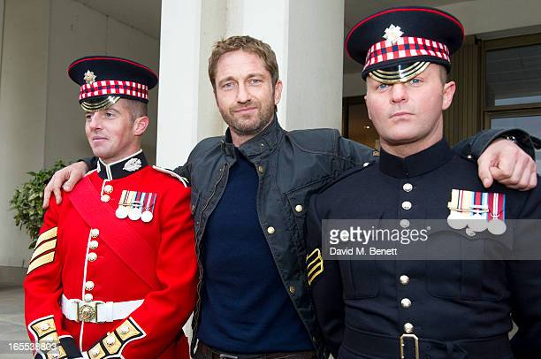 Gerard Butler poses with troops ahead of a special preview screening of Olympus Has Fallen released in cinemas on April 17 at Wellington Barracks on...